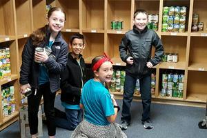 Students Volunteering at Caleb's Closet