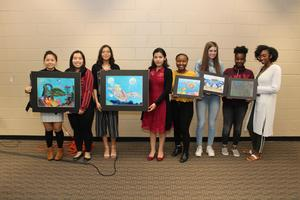 MISD Visual Arts students with their paintings