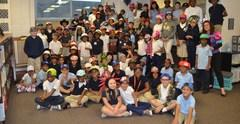 Students on hat day posing in the library of Conn West.