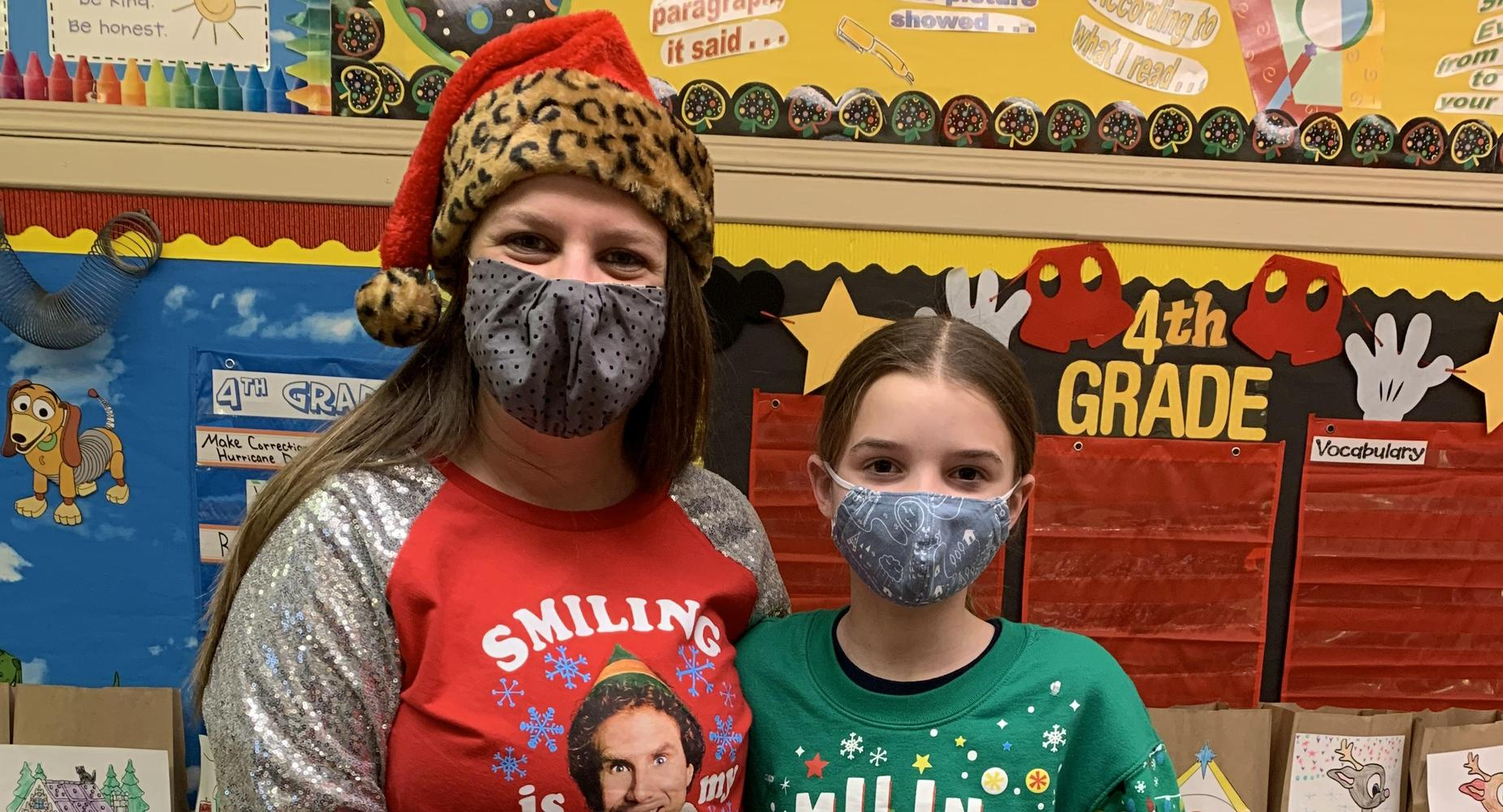 teacher and student in ugly Christmas Sweaters