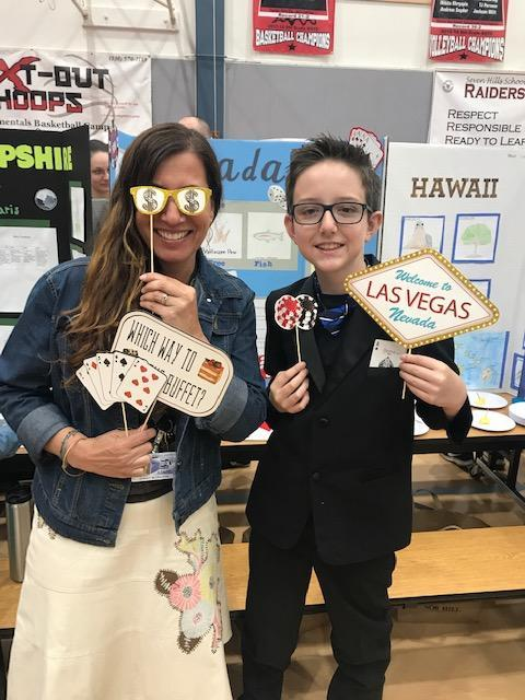 Teacher and Student posing for Nevada State during Seven Hills State Displays Fifth Grade