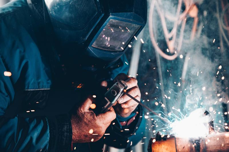 An image of a welder to illustrate that the website is under construction