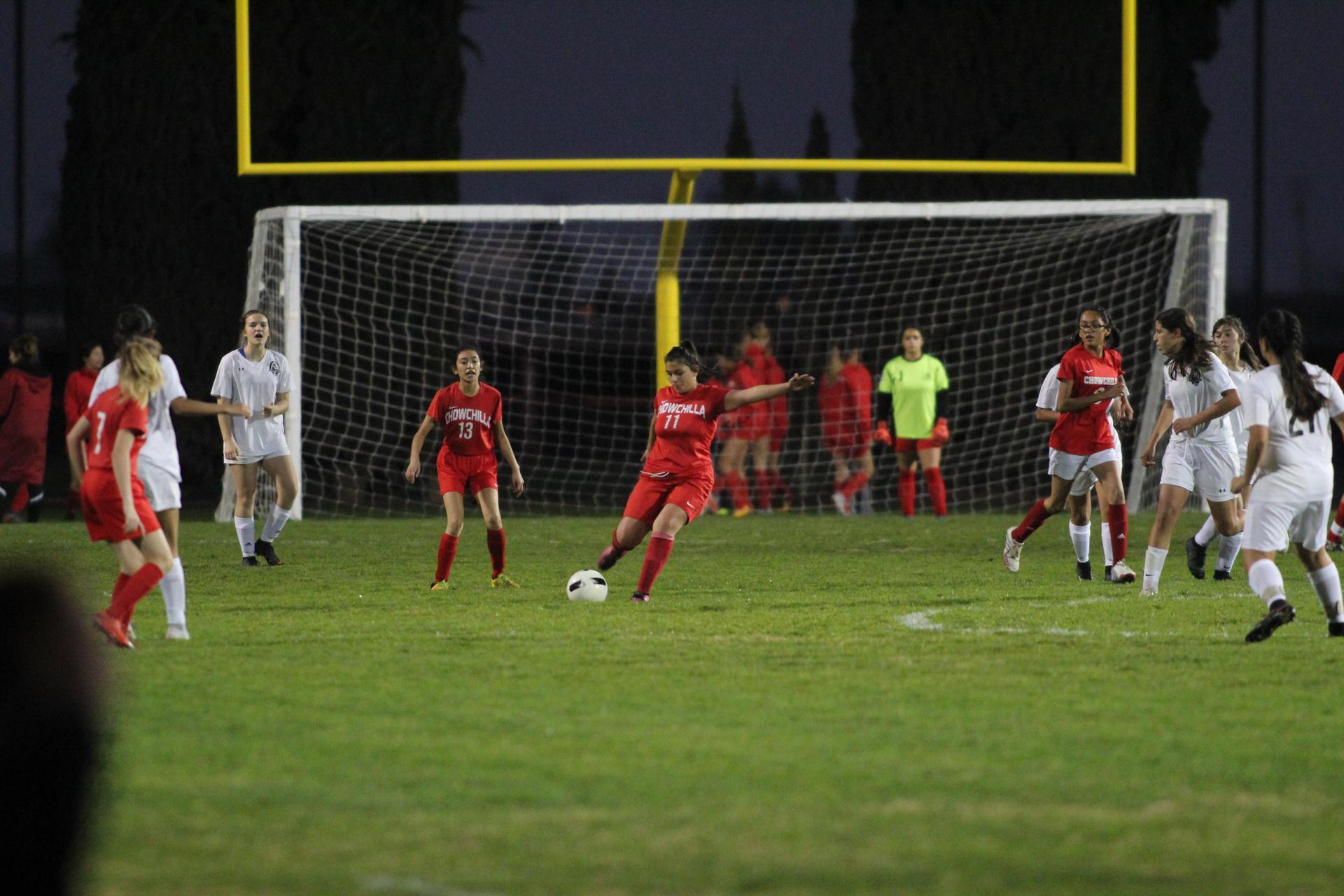 Girl's playing soccer against Merced.