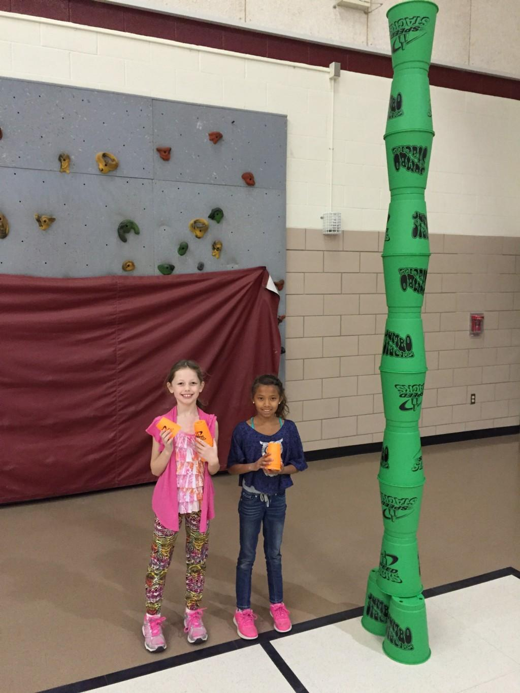 students celebrate their very tall stack of pails