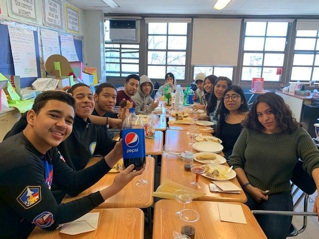 students sitting together eating lunch