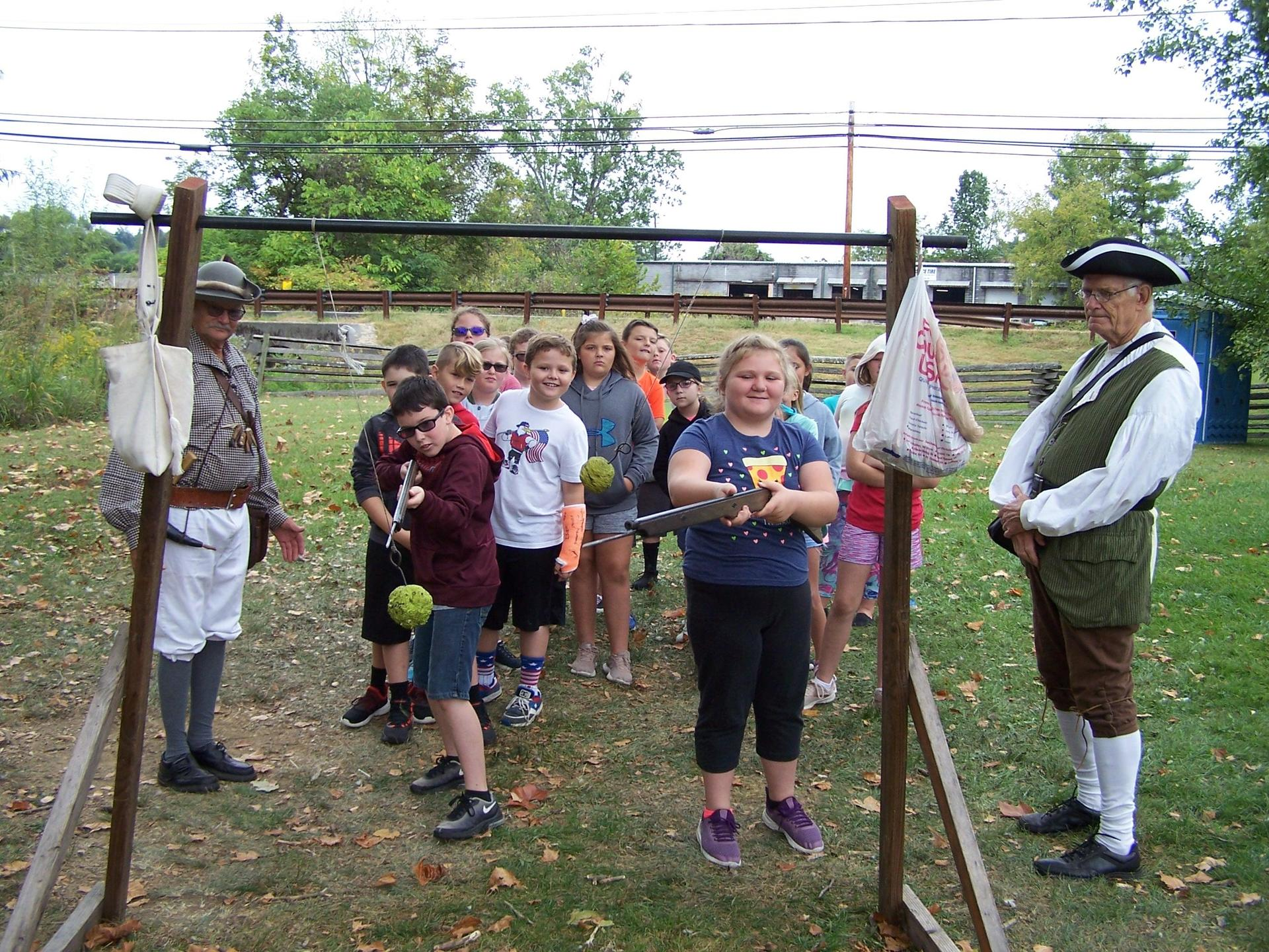 Students Mustering Grounds in Abingdon learning about Revolutionary War weapons