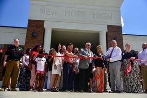 Leaders cutting the ribbon to New Hope High School.