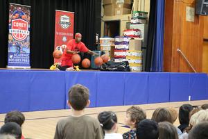 Corey the Dribbler, a former Harlem Globetrotter, provides energic & entertaining presentation during the Week of Respect.