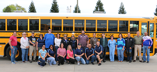 Transportation Staff in front of Bus