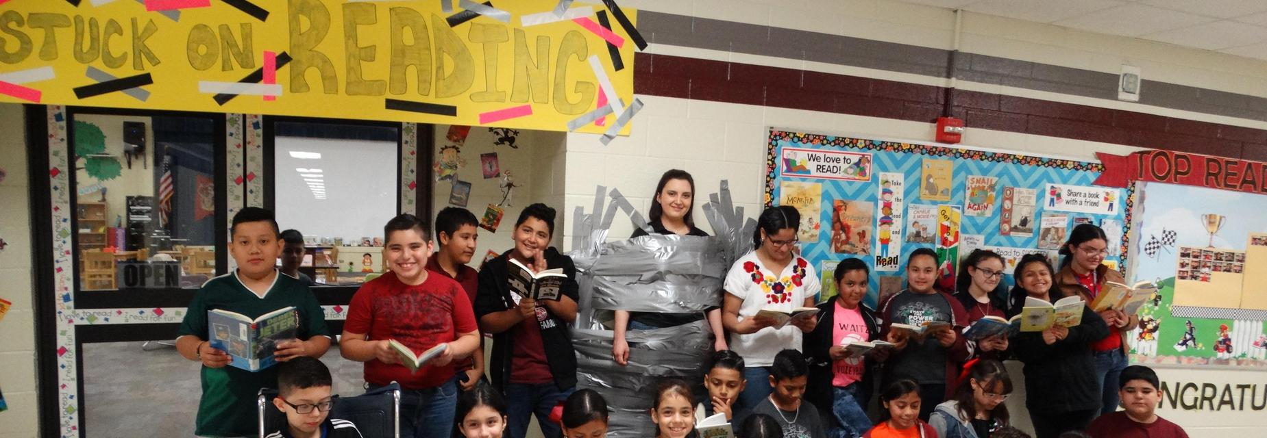 5th grade teacher taped to the wall