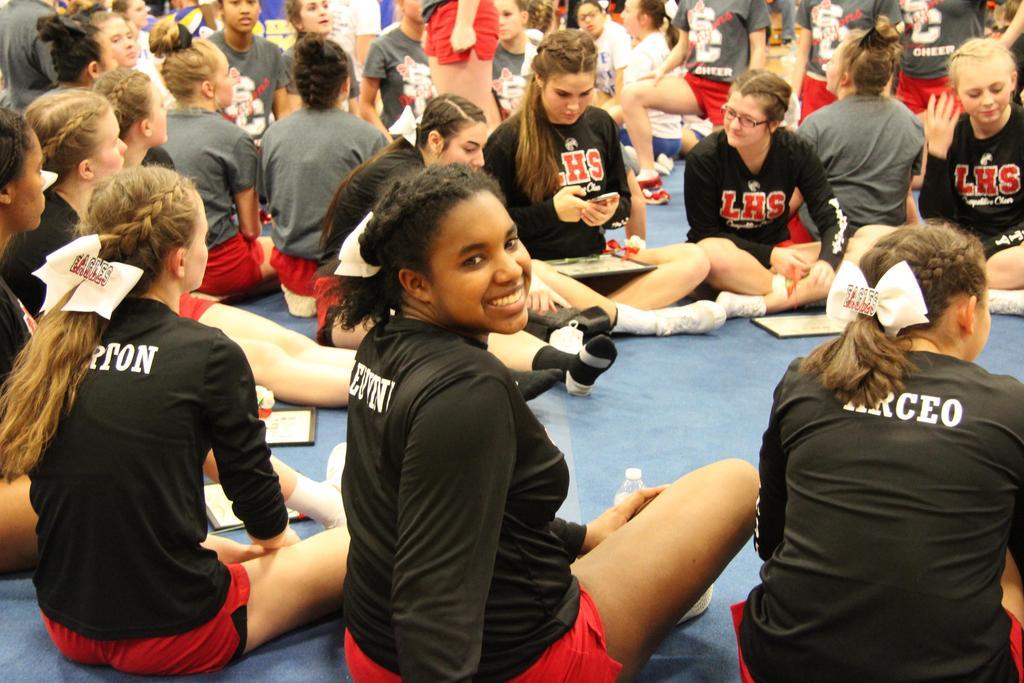 Cheerleader sitting on the floor