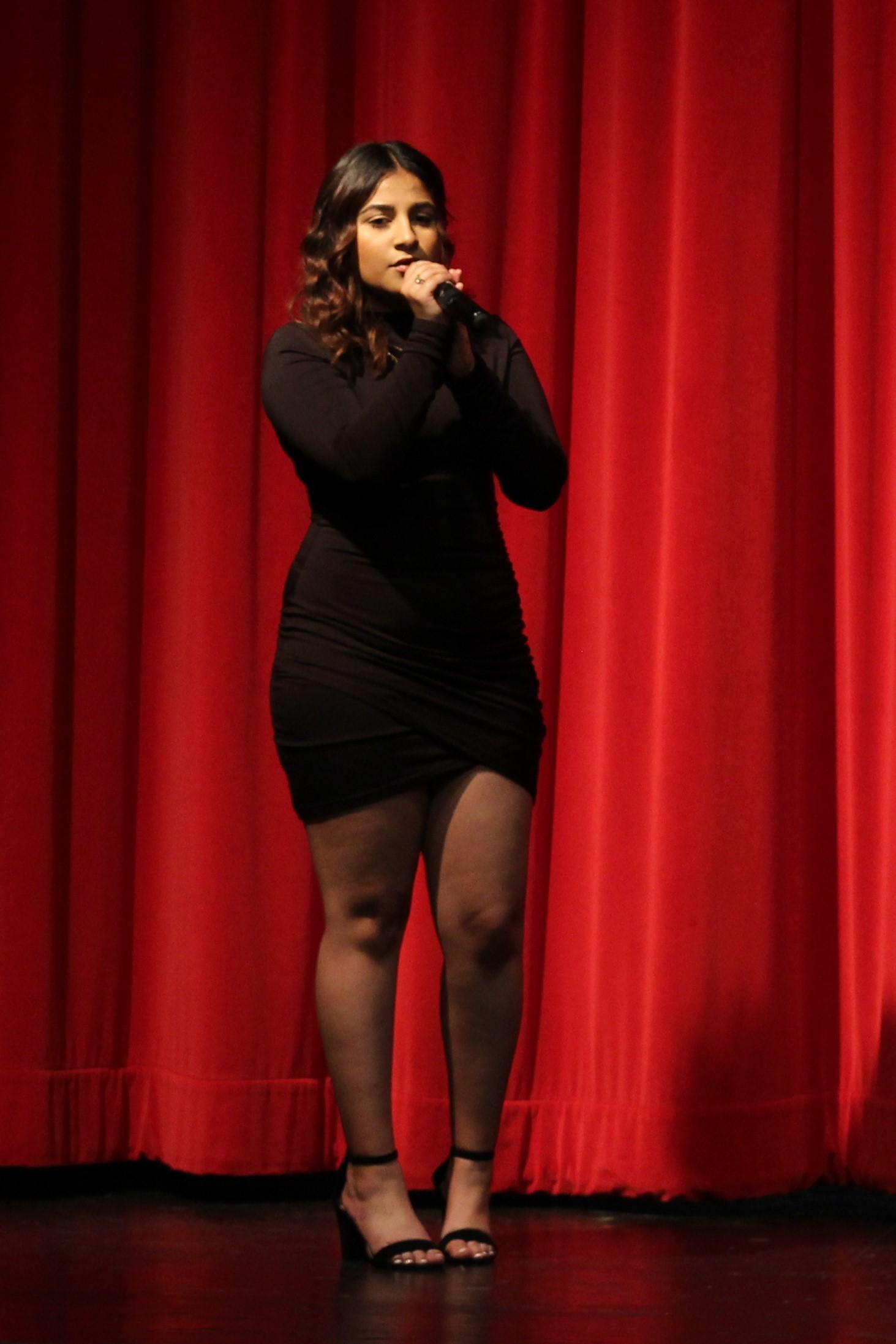 Jennifer Tapia-Martinez singing at the talent show