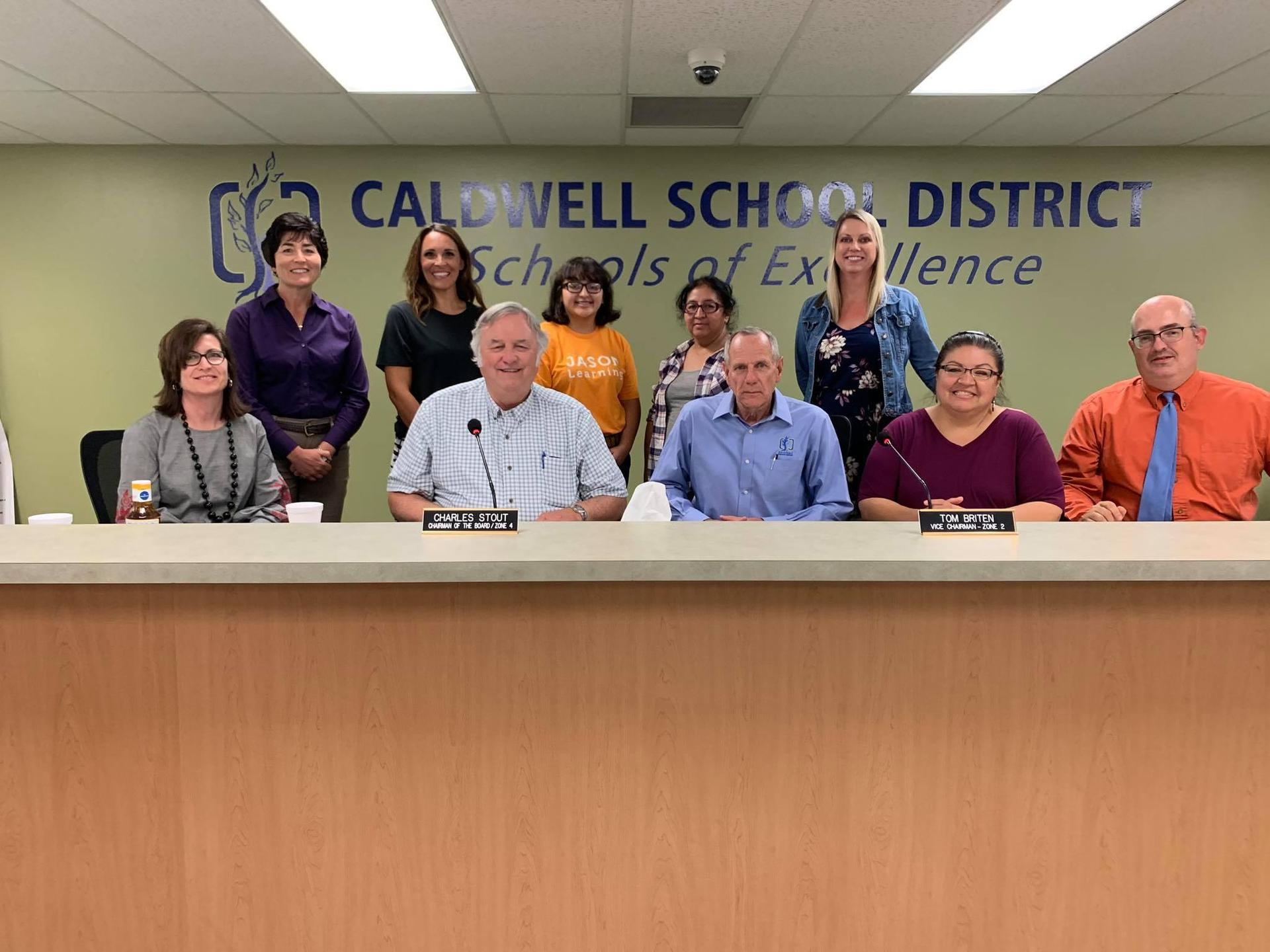 Caldwell High School Junior Daisy Estrada and math teacher Erin Lokteff with the Caldwell Board of Trustees.