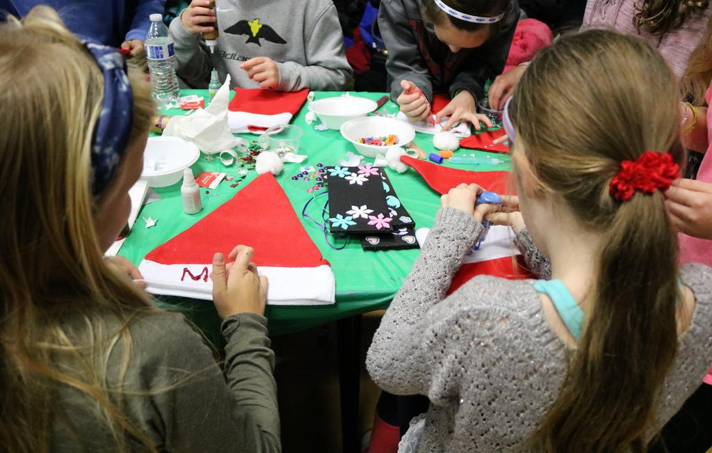 Photo of McKinley students participating in afterschool Handmade Holiday to create handmade crafts and gifts.