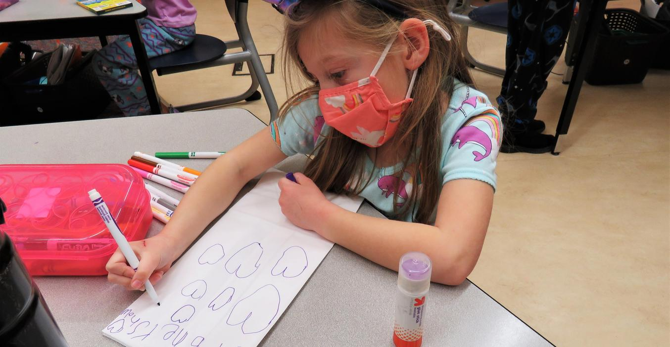 McFall students create Valentine's treat bags.