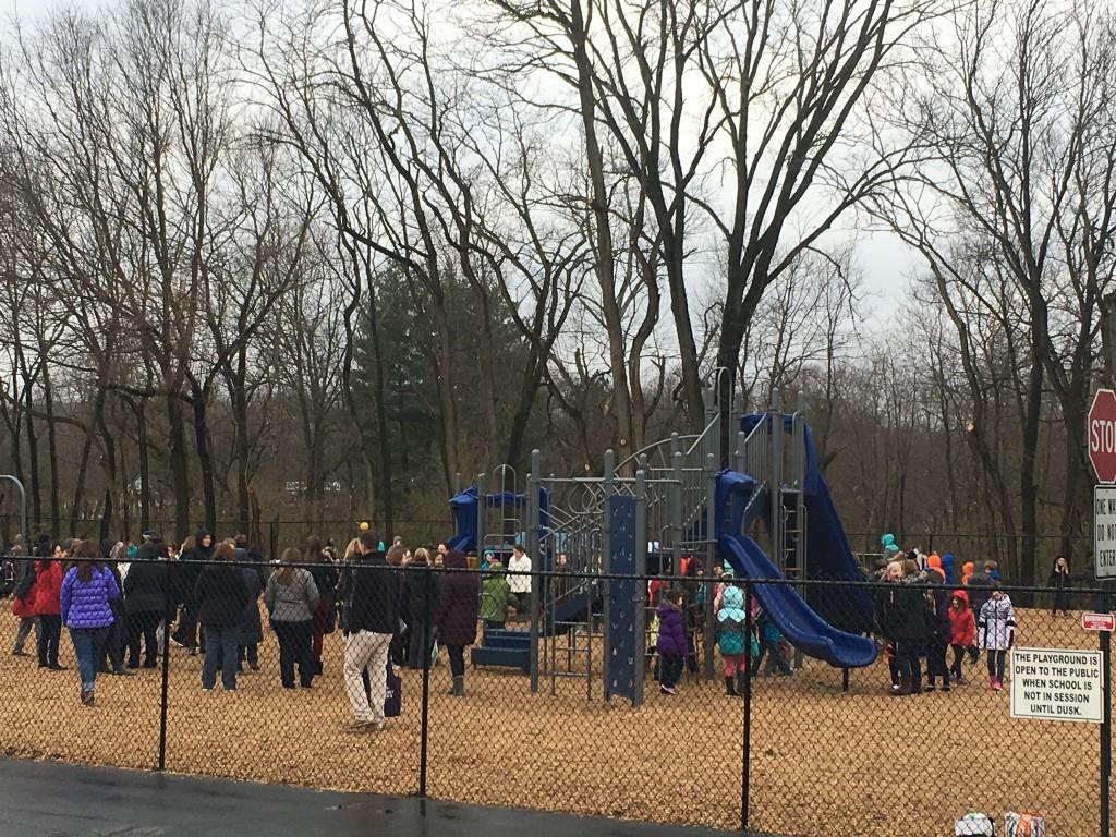 The students enjoy the new playground.