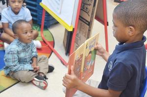 Student reading at Headstart