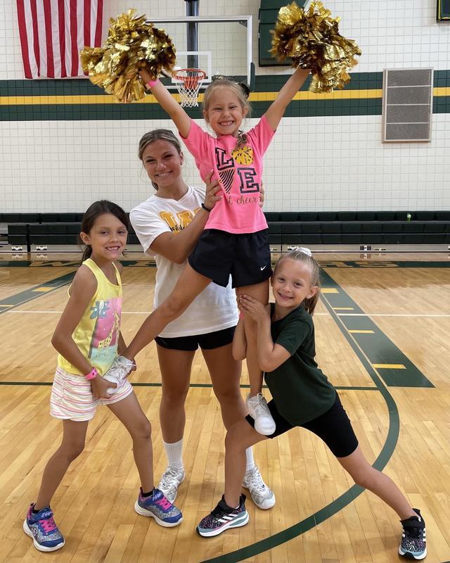 campers learn cheerleading skills