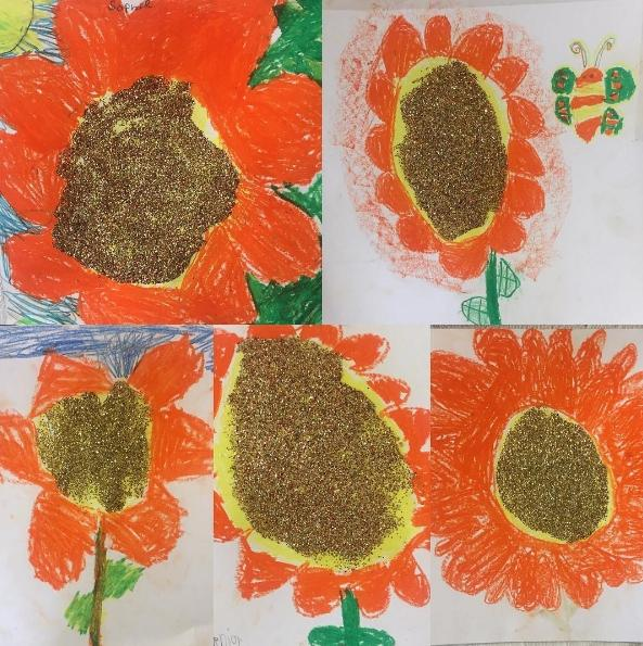 Bright orange sunflowers created by first grade students in art class