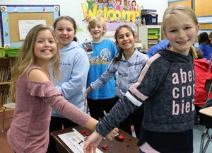 A group of McKinley students try their hands at an Odyssey of the Minds challenge during the school's annual STEAM Night on Jan. 24.