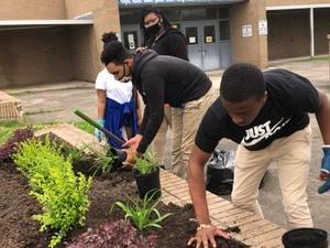 Underclassmen working together to prepare Rams Garden