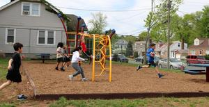 Photo of excited McKinley students running to try out the new playground at McKinley.