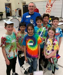 (L-R) Franklin Elementary School students Devan Regas (Grade 5), Takato Kaneda (Grade 3), Siya Singla (Grade 3), Luca Giacobbe, Alex Giangone (Grade 5), Lexie Twilley (Grade 3), and Ben Britain (Grade 5), pictured here with coach Andrea Giangone, placed 2nd in the regional Odyssey of the Mind competition in March.