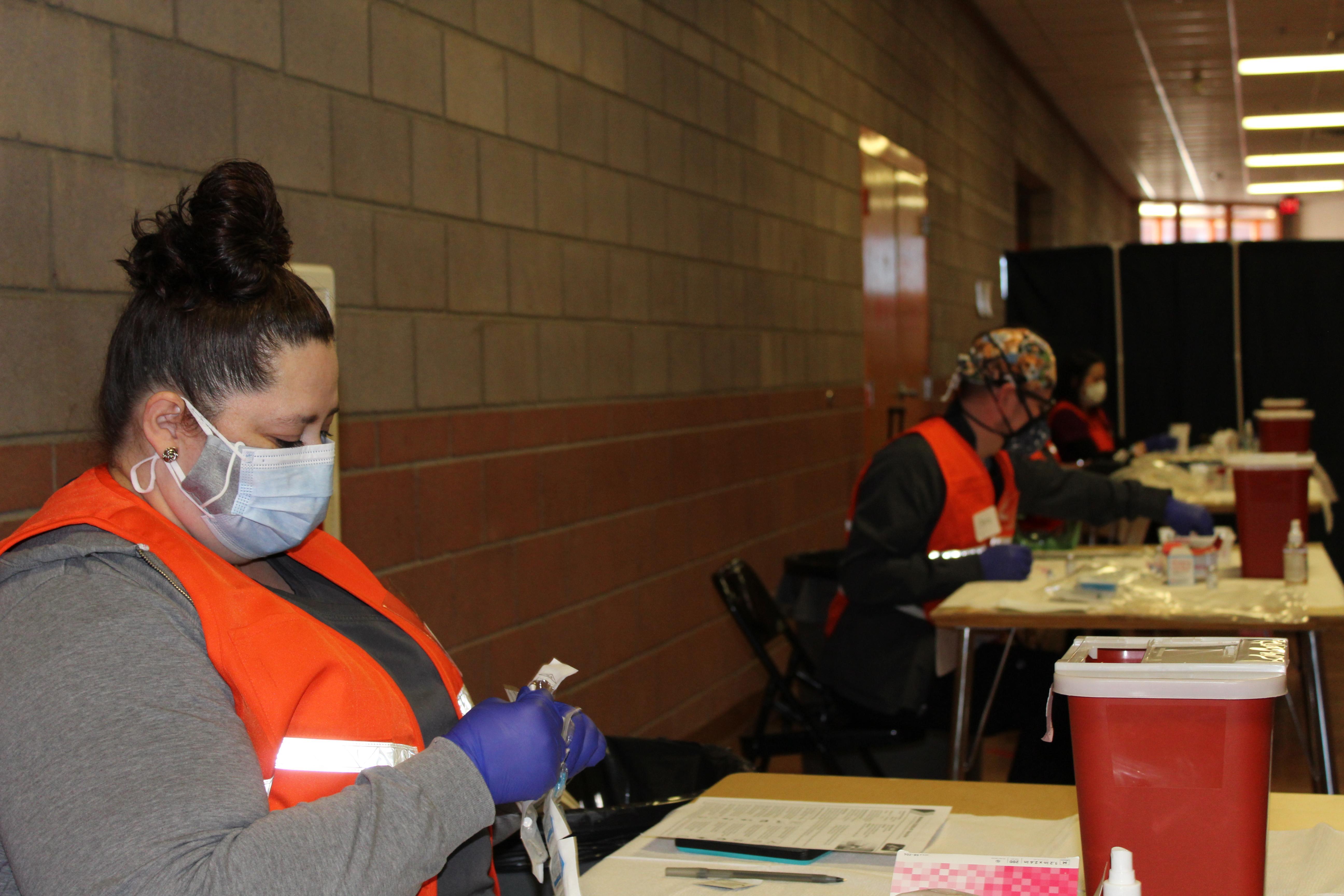 GMCS Nurses drawing up vaccines