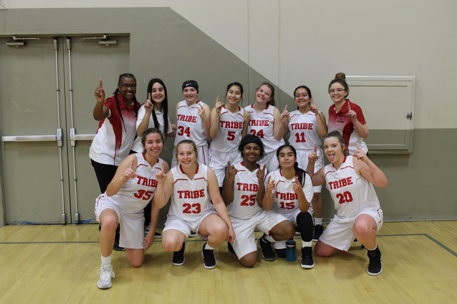 JV Girls pose after winning the NSL Basketball Championship
