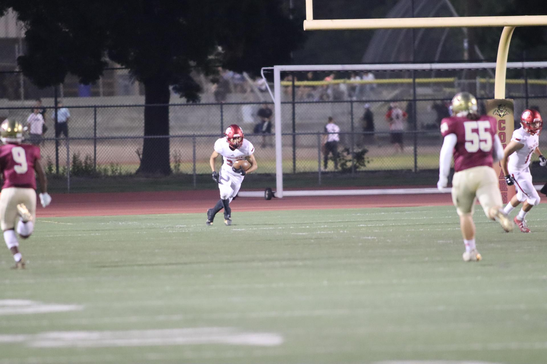 Varsity boys playing football against Golden Valley