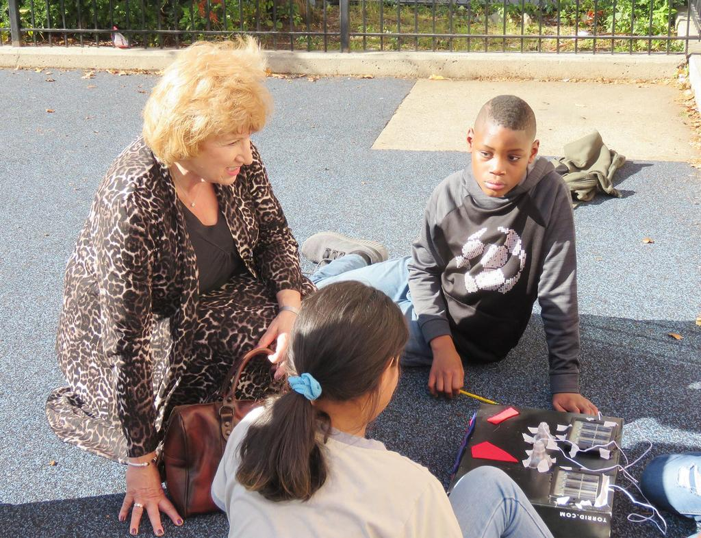 Superintendent of Schools Janice Gauthier admires the work of Lafayette School students