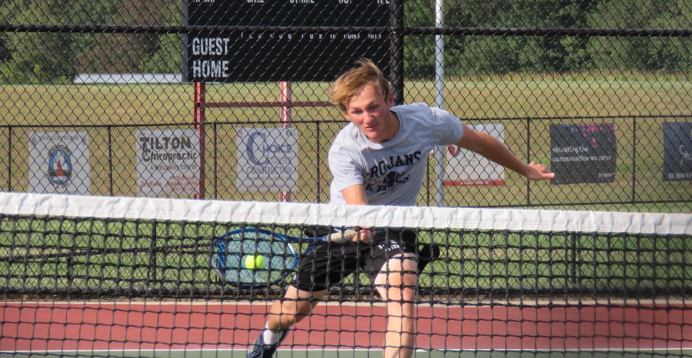 A TK varsity tennis player lunges for a return.