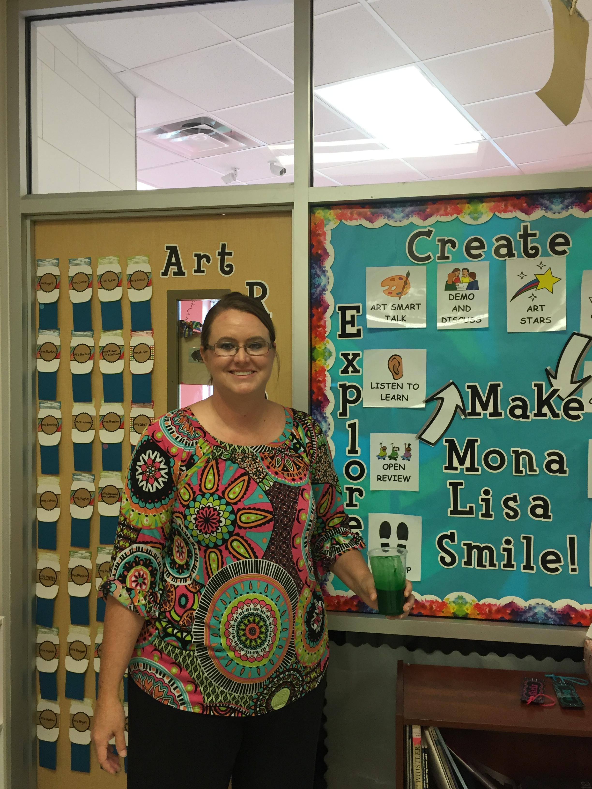 picture of new art teacher Mrs. Goodson in her classroom