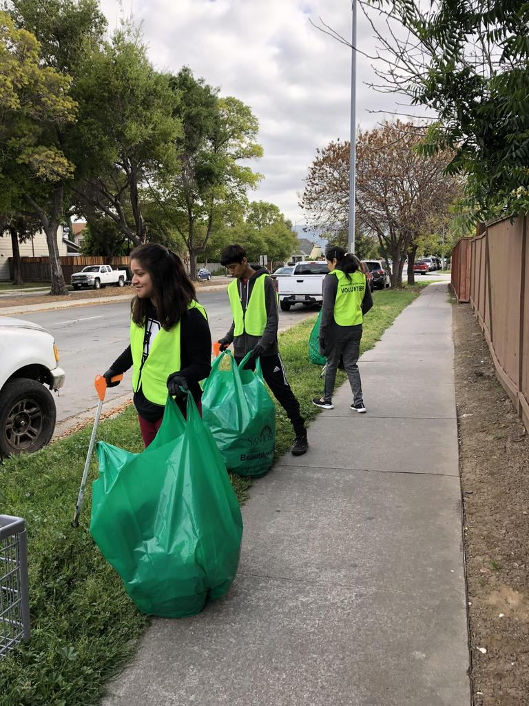 CCA volunteers participate in neighborhood clean-up.