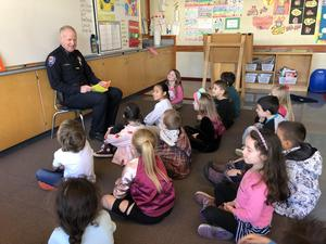 Police Chief reading to first grade students