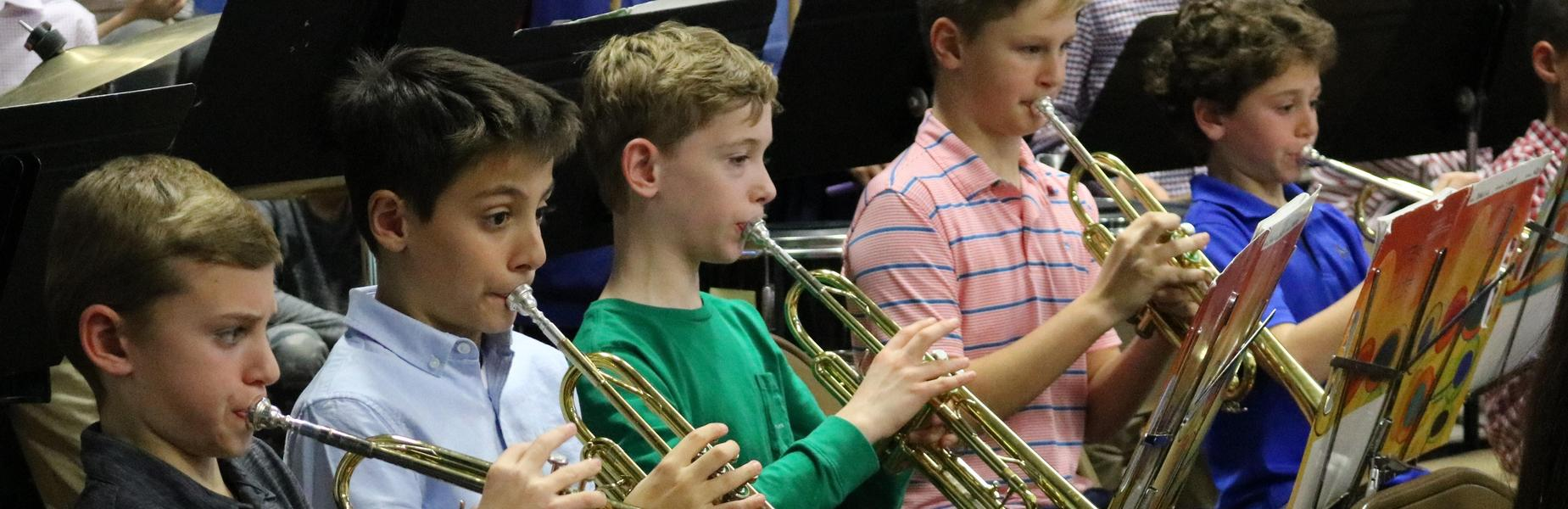 Five 5th grade trumpeters perform with the Wilson School band and chorus holiday concert in December 2018.