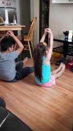 brother and sister doing yoga side by side