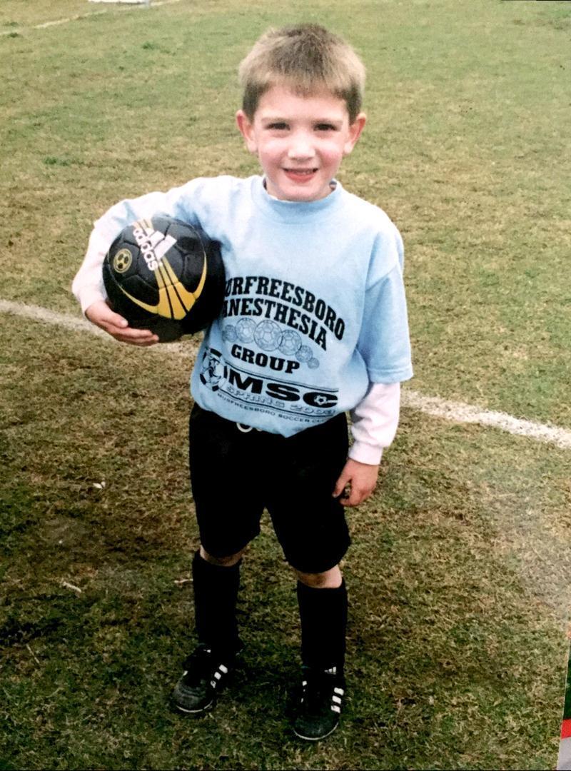 Chase Donnell holding football helmet