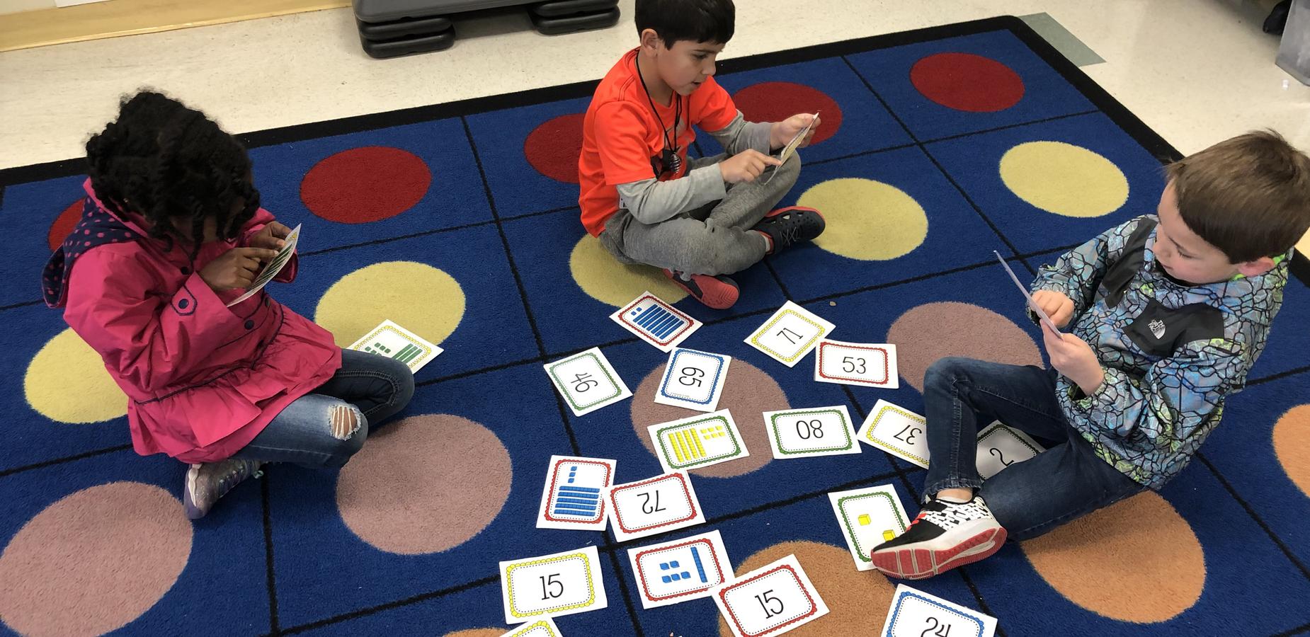 Kindergarten students working with numbers