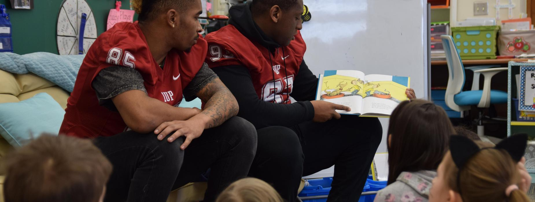 IUP Football players reading