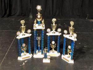 a photo of all the Baker High Band and Dancers awards won for outstanding performances at the Music USA Invitational Festival in Florida