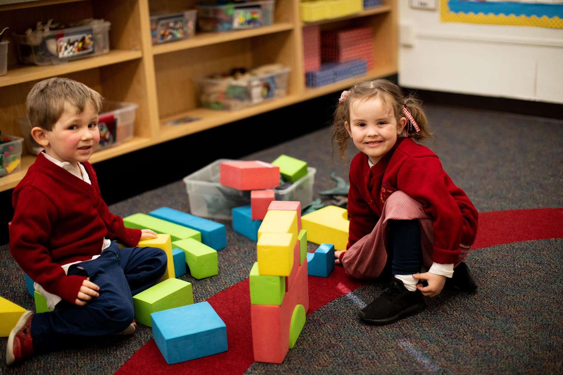 Preschool students playing with building blocks