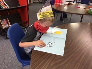 boy working on hat
