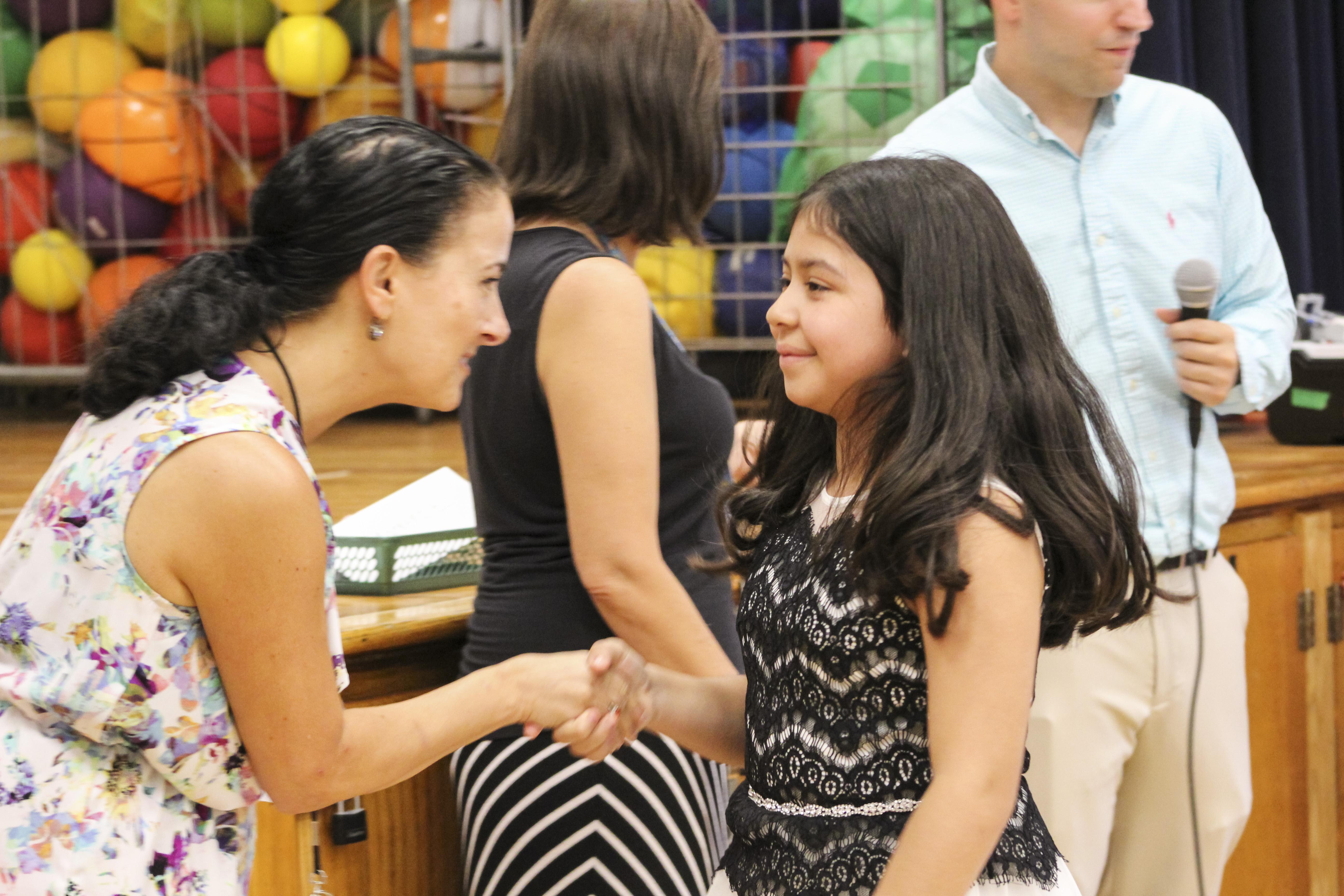 Student shaking principal's hand