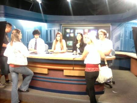 Students practicing at TV studio news station