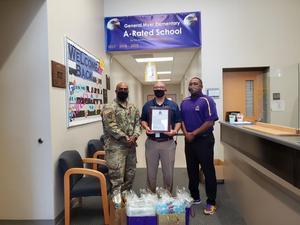 Principal accepting donations
