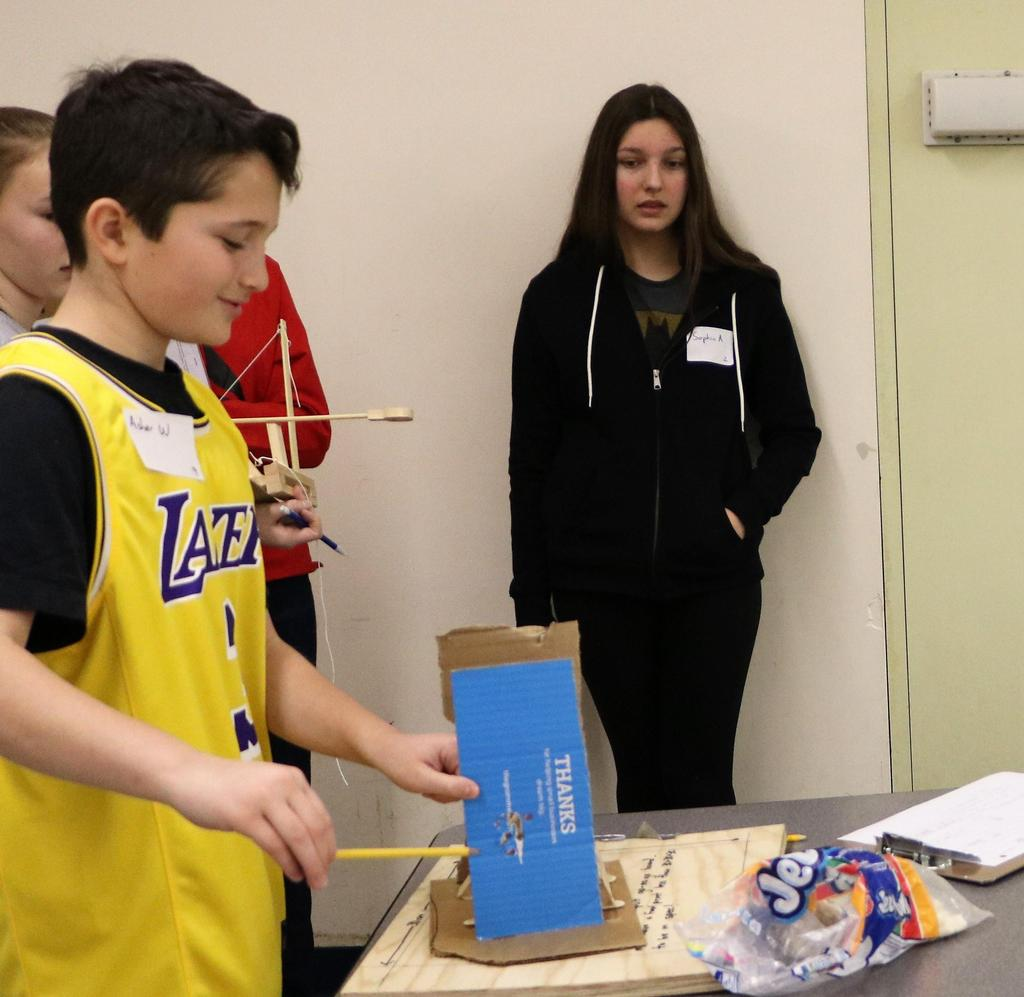 Photo of student testing handmade catapult during Science Olympiad at Roosevelt Intermediate School.