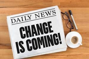Newspaper image with headline Change is Coming!