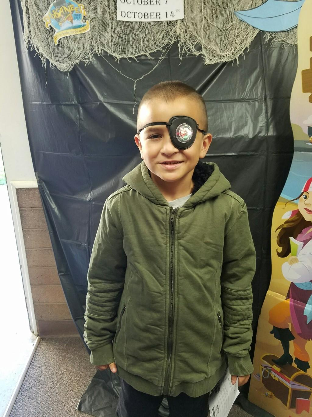 student dressed as pirates at bookfair