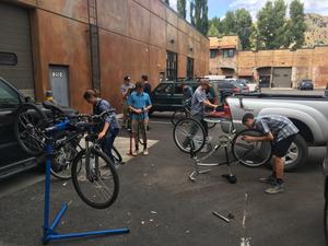 Students fixing bikes